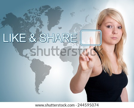 Young woman press digital Like and Share button on interface in front of her - stock photo