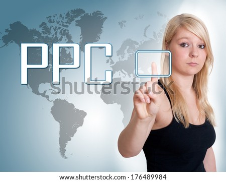 Young woman press digital Pay per Click button on interface in front of her - stock photo