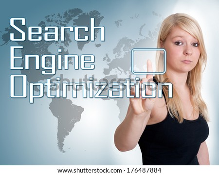 Young woman press digital Search Engine Optimization button on interface in front of her - stock photo