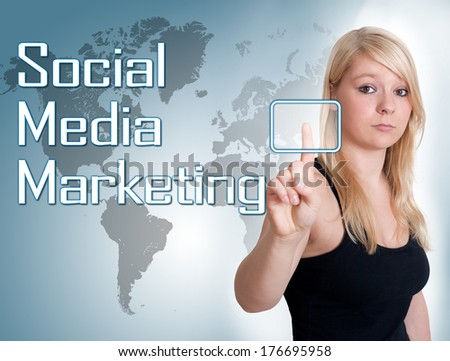 Young woman press digital Social Media Marketing button on interface in front of her - stock photo