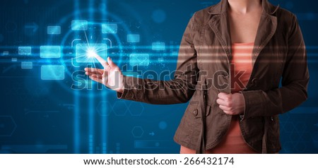 Young woman pressing high tech type of modern buttons  - stock photo