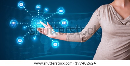 Young woman pressing virtual messaging type of icons
