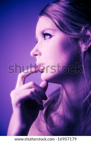 Young woman profile portrait. Soft blue and pink tint. - stock photo