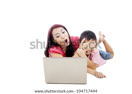 Young woman protect her son from internet influence by covering his eyes
