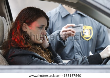 Young woman pulled over by police - stock photo