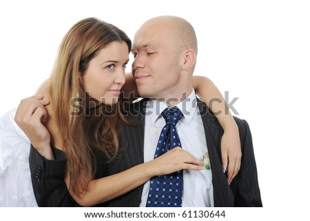 young woman pulls money out of pocket businessman. Isolated on white - stock photo