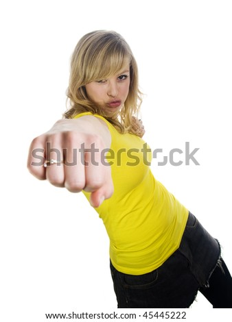 Young Woman Punching Toward Camera - stock photo