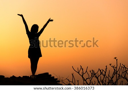 Young woman raise hands up for her success, Concept of Success in life