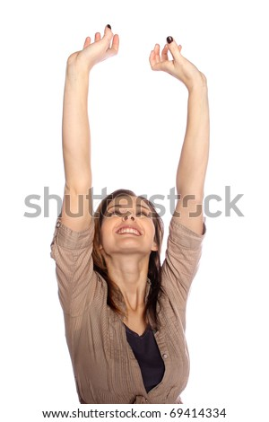 Young woman reaching up to the sky - stock photo