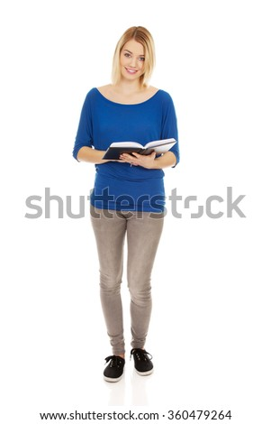 Young woman reading a book. - stock photo