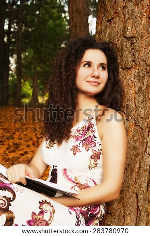 Young woman reading a book. Education