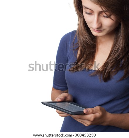 Young woman reading e-book device isolated on white with copy-space - stock photo