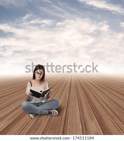 young woman reading sitting at abstract place