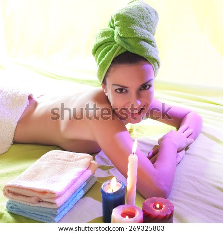 Young woman ready for getting a massage, lying down
