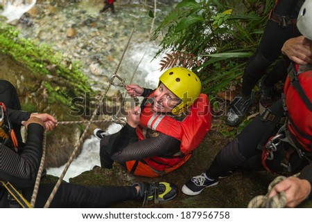 Young woman ready to lunch on zipline, Llanganates National Park, Ecuador - stock photo