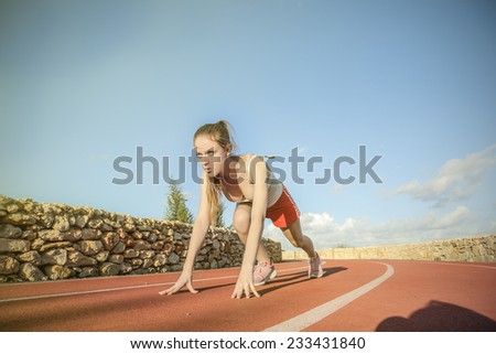 Young woman ready to run  - stock photo