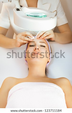 Young woman receiving beauty therapy - stock photo