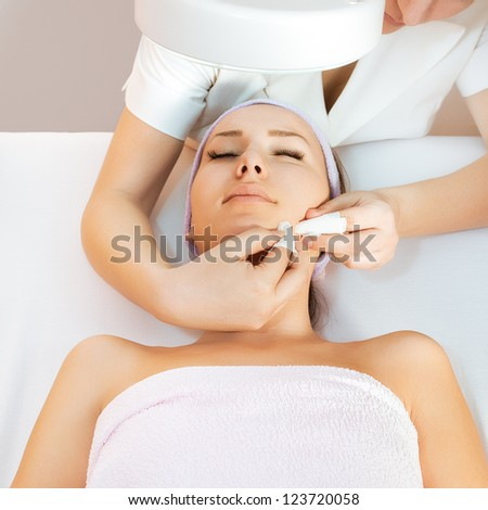Young woman receiving spa treatment - stock photo