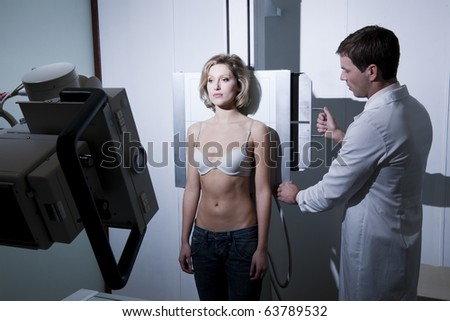 Young woman receiving x-ray scan - stock photo