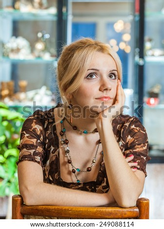 Young woman reflects on life. - stock photo