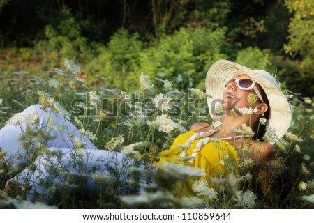 Young woman relaxed in grass - stock photo