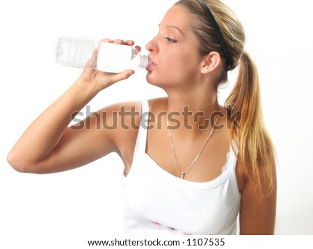 Young woman relaxes with bottled water after workout