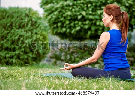 young woman relaxes with closed eyes practicing advanced yoga Concept healthy lifestyle. Lots of copy space. Selective focus