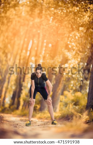 Young woman relaxing after work out in the park