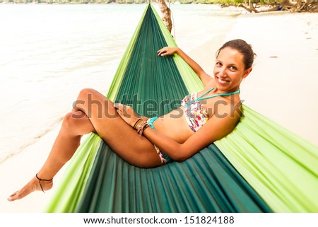 young woman relaxing in a hammock - stock photo