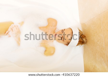 Young woman relaxing in bath - stock photo