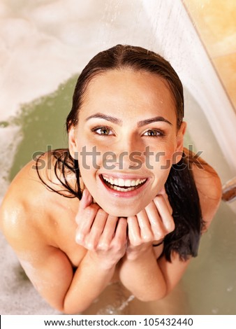 Young woman relaxing in bubble  bath. - stock photo
