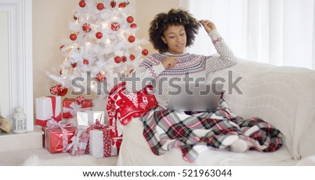 Young woman relaxing in front of a Christmas tree