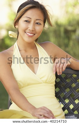 Young Woman Relaxing In Garden