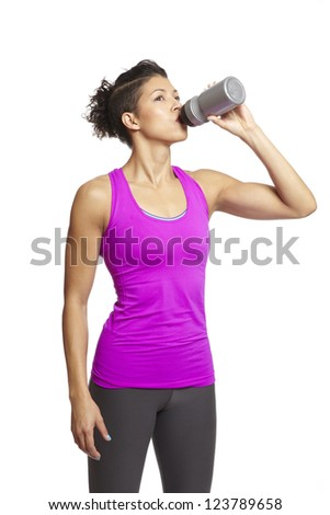 Young woman relaxing in sports outfit on white background - stock photo