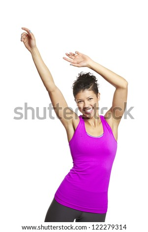 Young woman relaxing in sports outfit smiling on white background