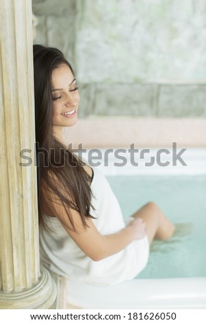 Young woman relaxing in the hot tub - stock photo