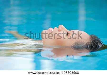 Young woman relaxing in the water - stock photo