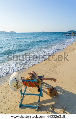 Young woman relaxing on a beautiful exotic beach.