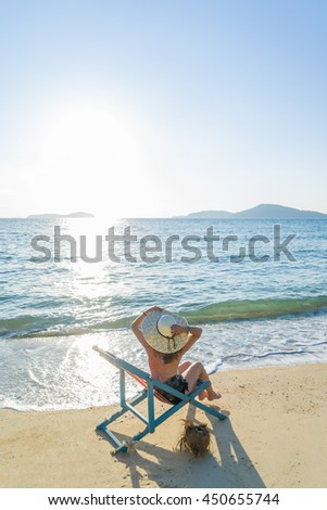 Young woman relaxing on a beautiful exotic beach. - stock photo