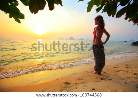 Young woman relaxing on a tropical beach - stock photo
