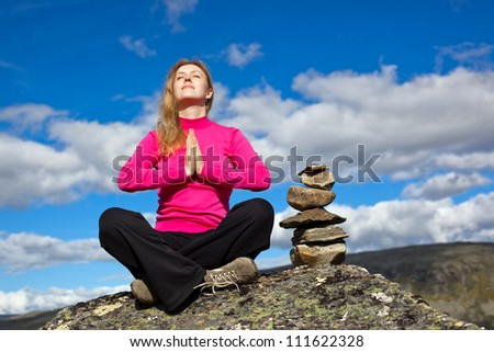 Young woman relaxing on mountains. - stock photo