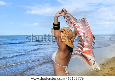 Young woman relaxing on the beach. England. - stock photo