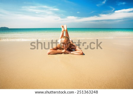 young woman relaxing on the tropical beach - stock photo
