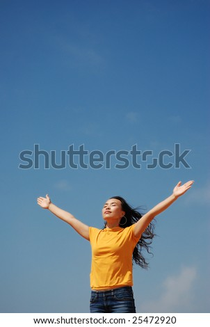 Young Woman Relaxing over blue sky