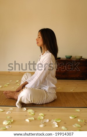 Young woman relaxing, side view - stock photo