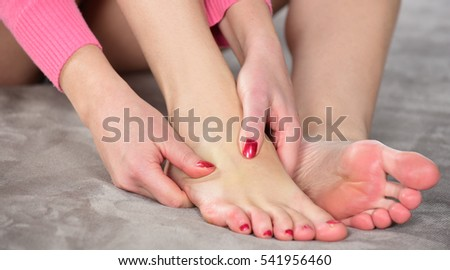 Young woman relaxing with hand massage