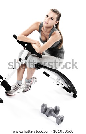 Young woman resting after exercising - stock photo