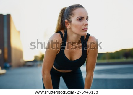 Young woman resting after running exercise - stock photo