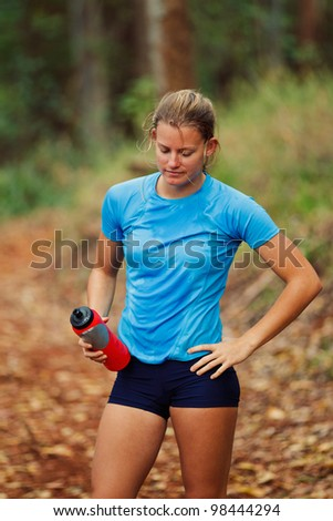 Young Woman Resting after Work Out Run