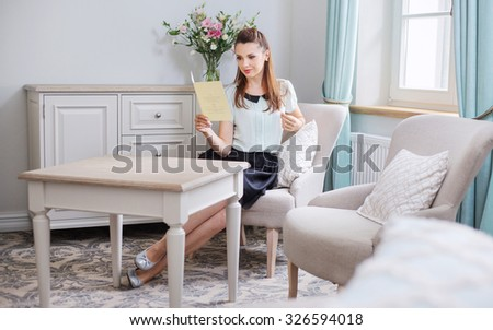 Young woman resting at home - stock photo